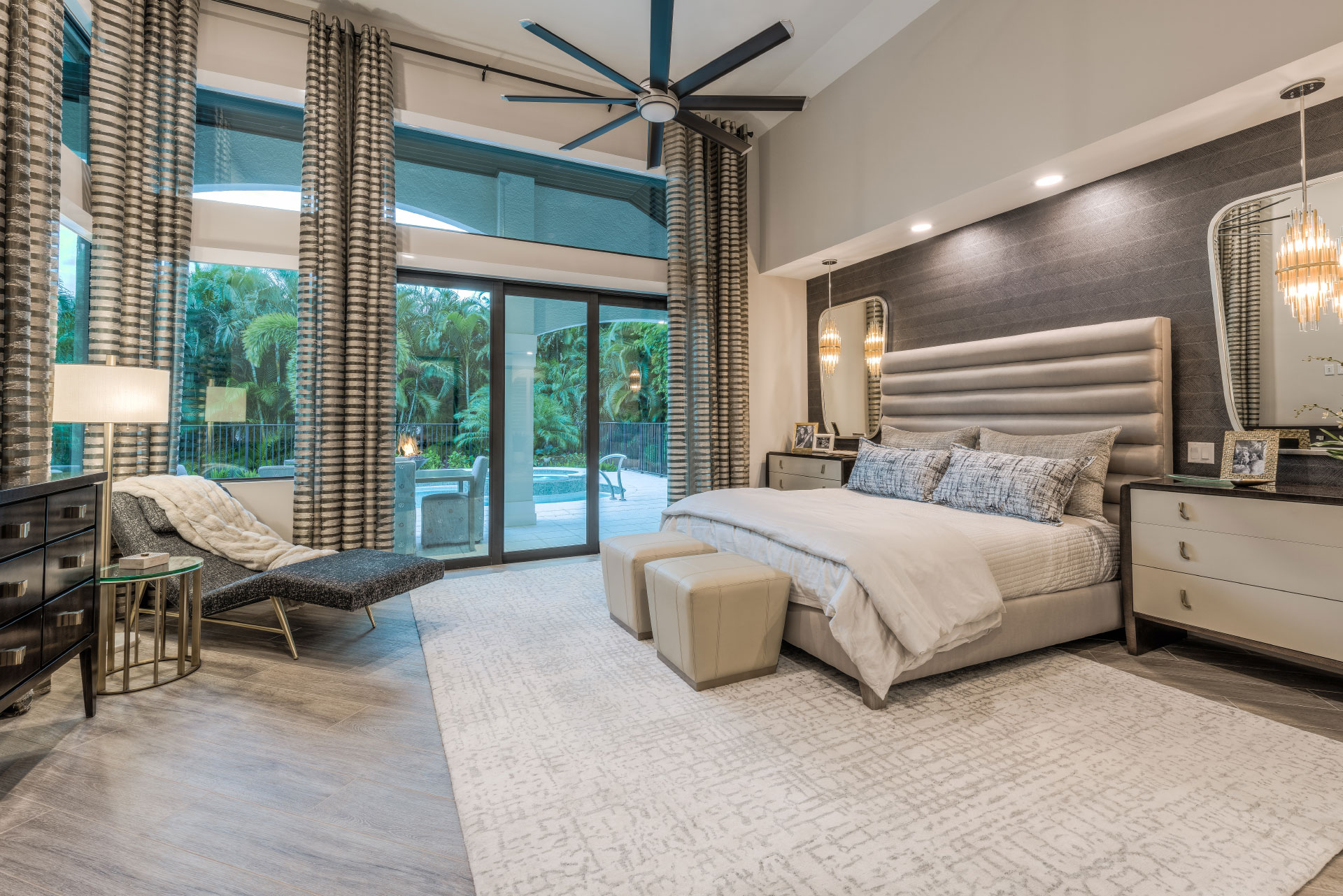 Lykos Group bedroom with window looking to the pool