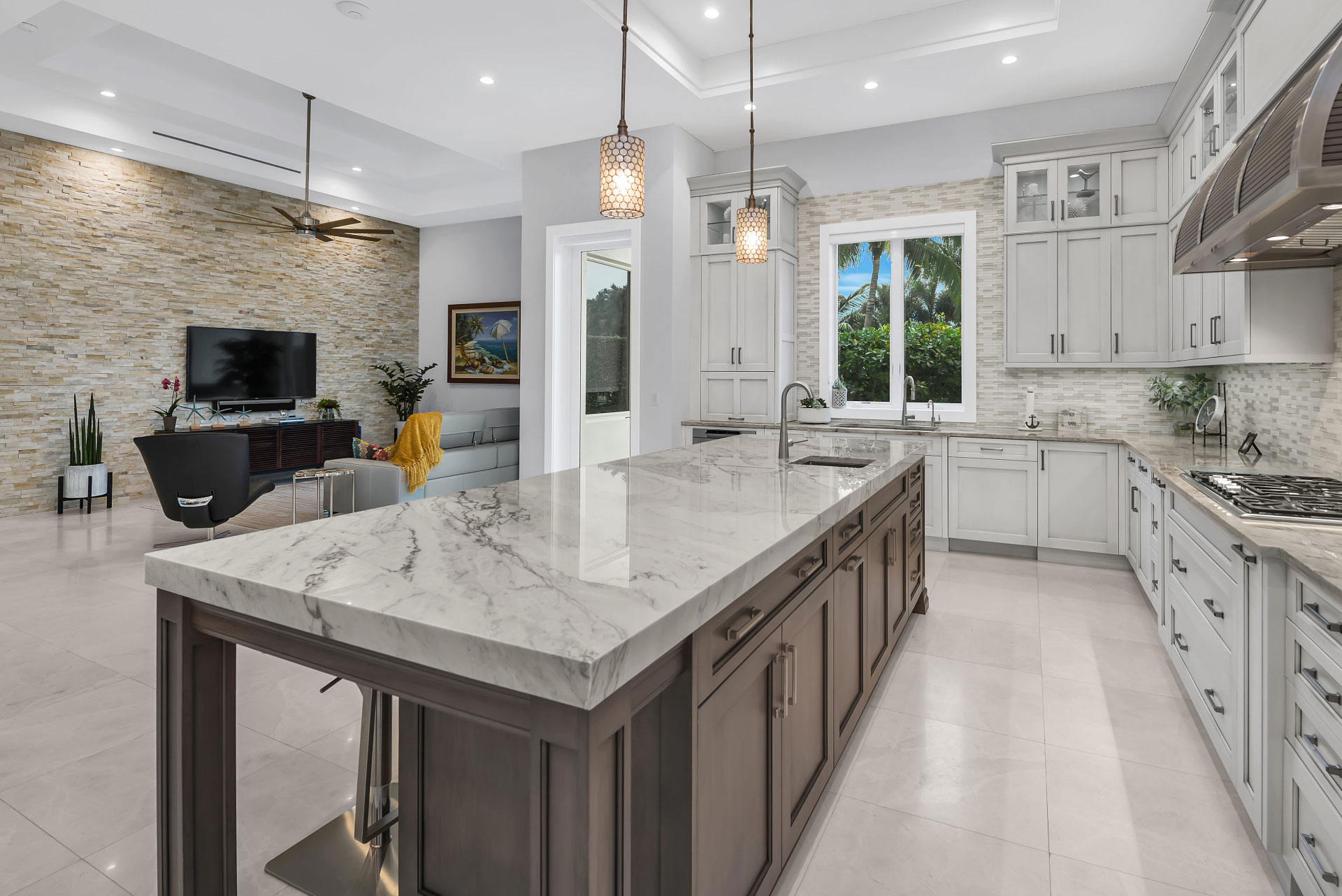 Lykos Group kitchen with a beautiful island overlooking a fireplace